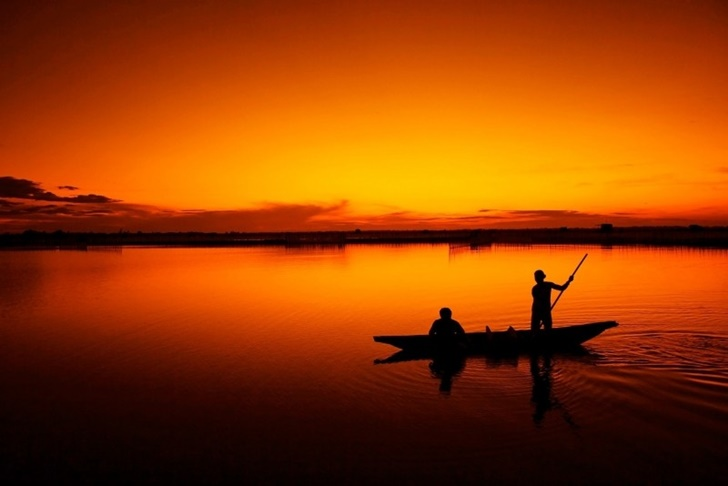 fishermen-on-lake-at-sunset